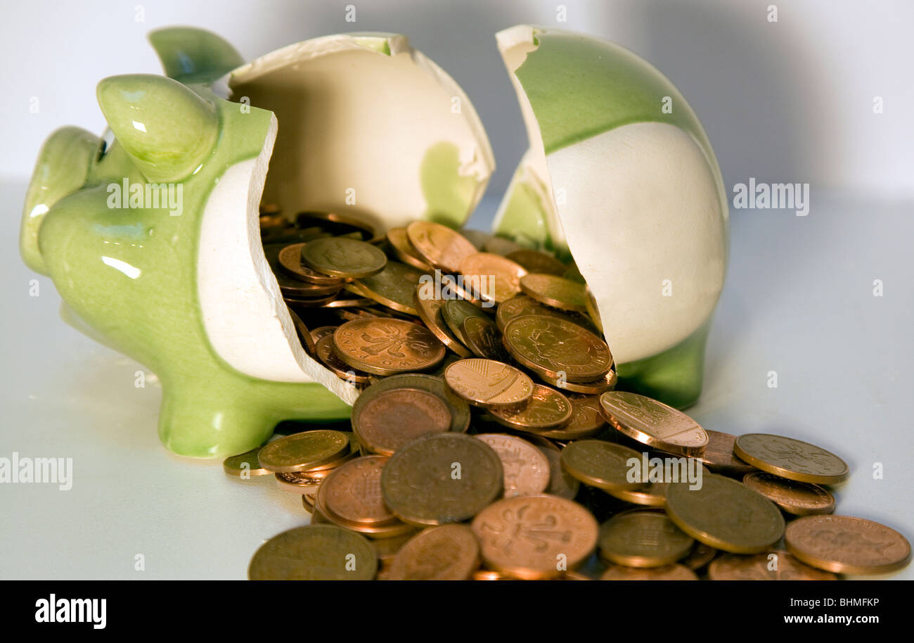 Broken piggy bank with coins Stock Photo