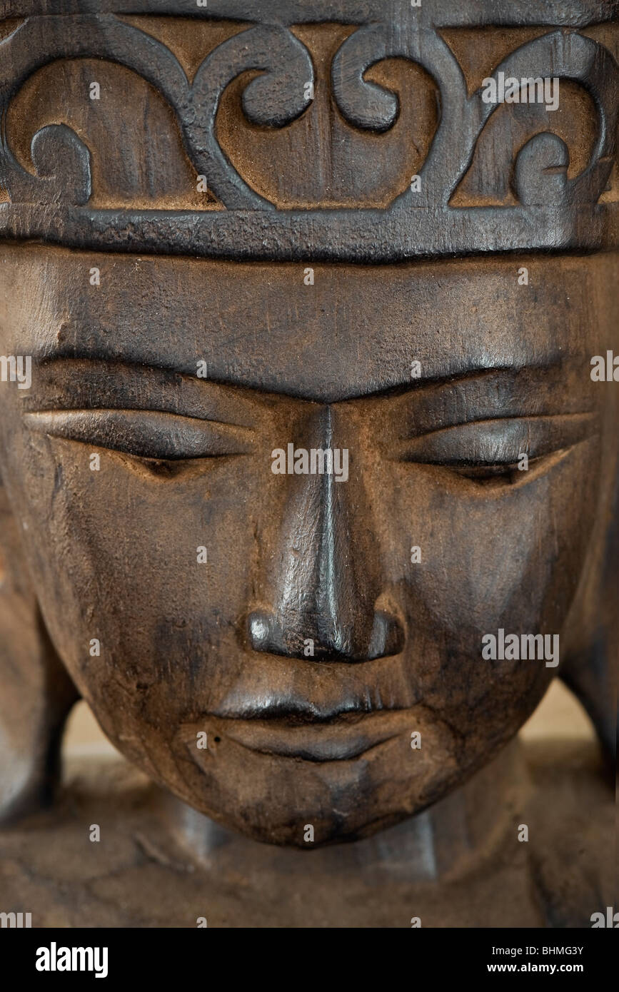 Wooden Buddha carving. - Stock Image