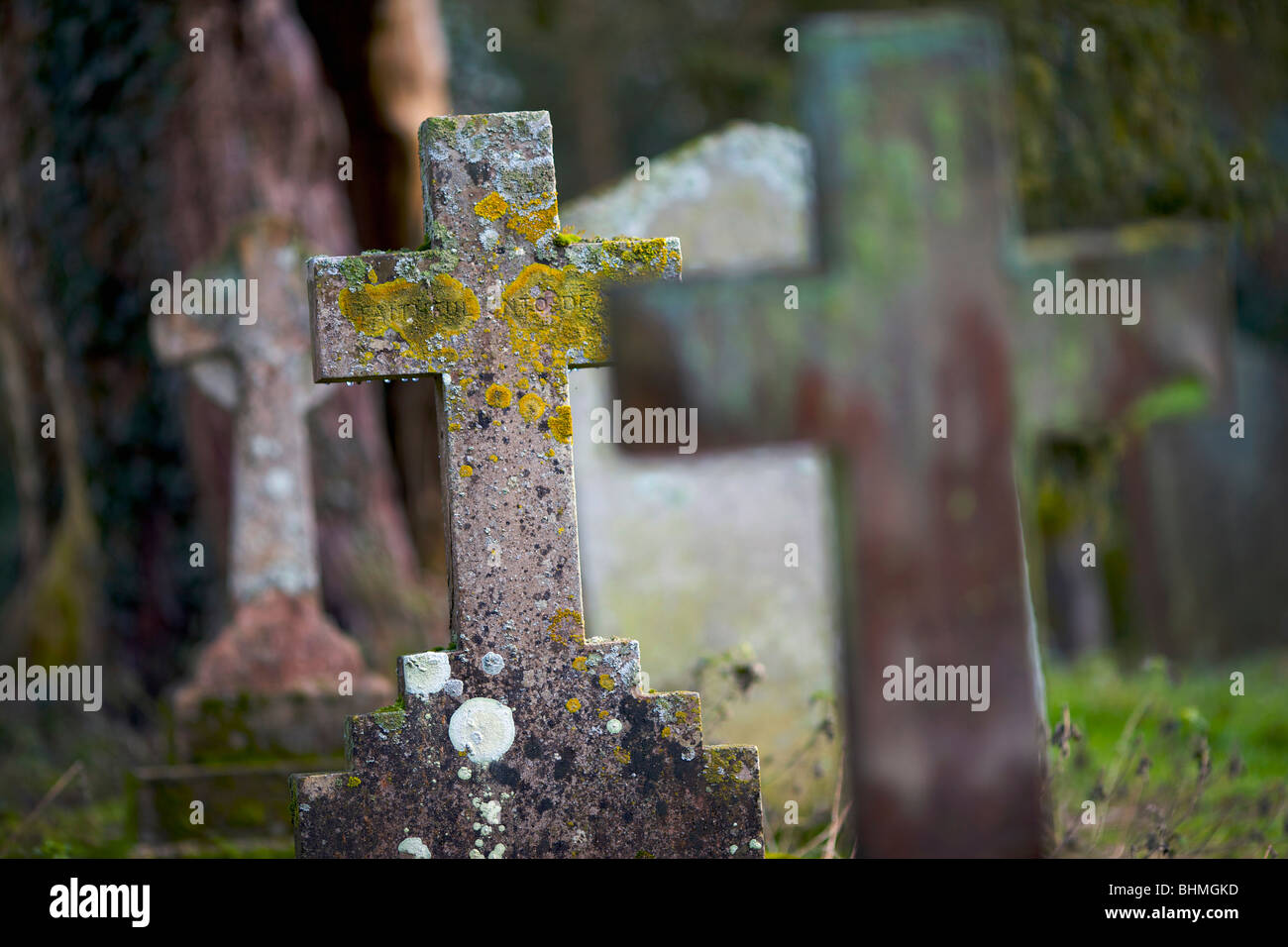 Cross gravestones in an English country churchyard - Stock Image