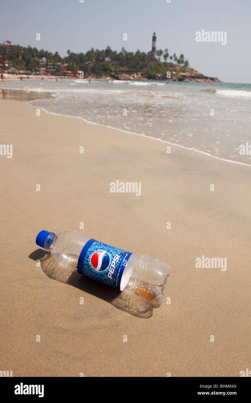 India, Kerala, Kovalam, Lighhouse Beach, discarded plastic soft drinks bottle on shore Stock Photo