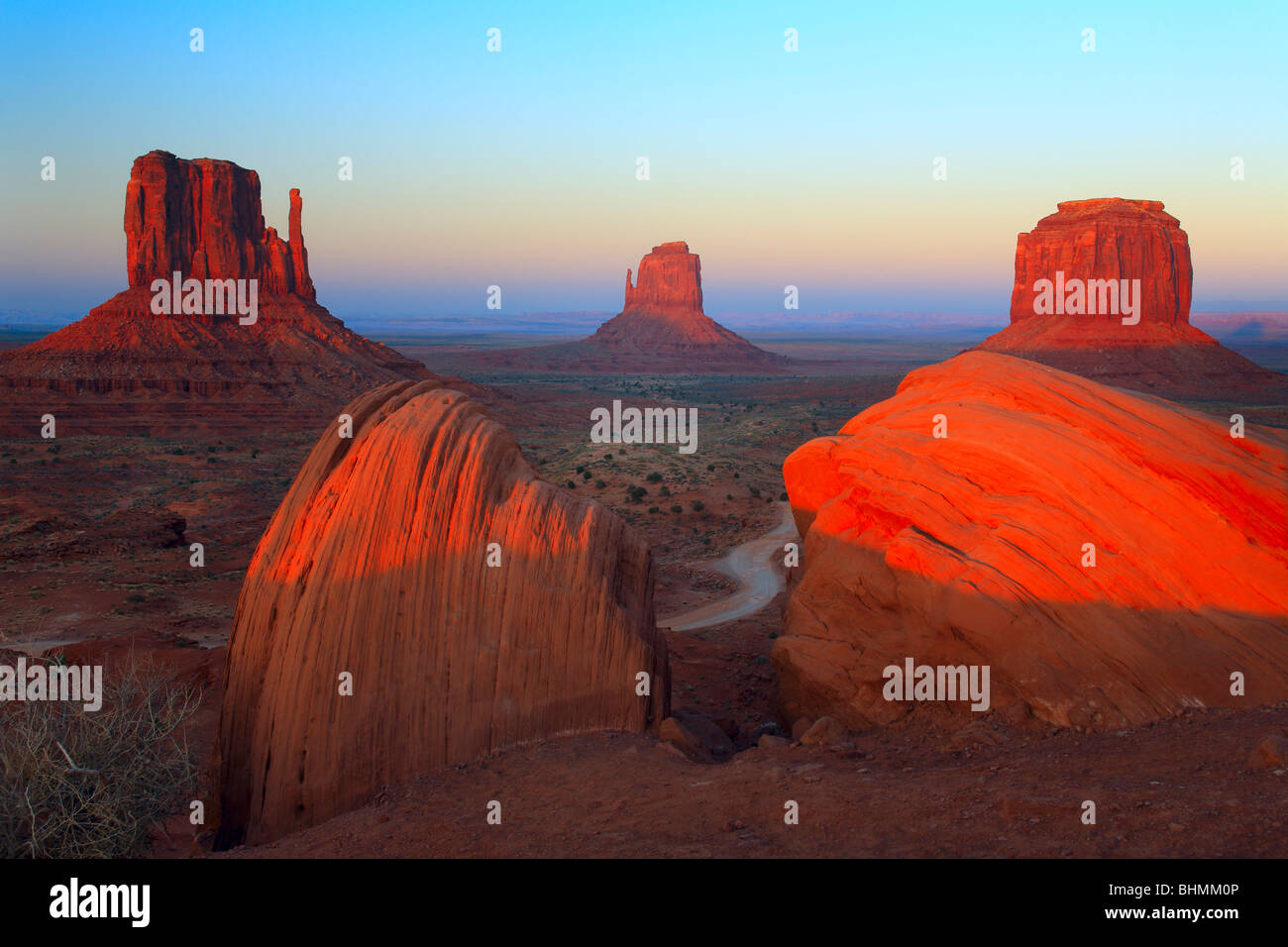 Classic view of the Mittens and Merrick Butte in Monument Valley, AZ - Stock Image