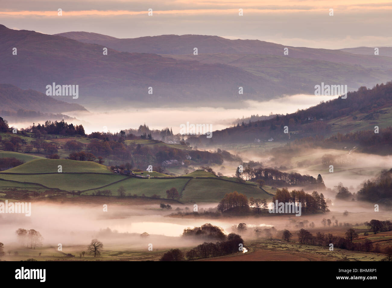 Little Langdale surrounded by mist at dawn, Lake District National Park, Cumbria, England, UK. Autumn (November) - Stock Image