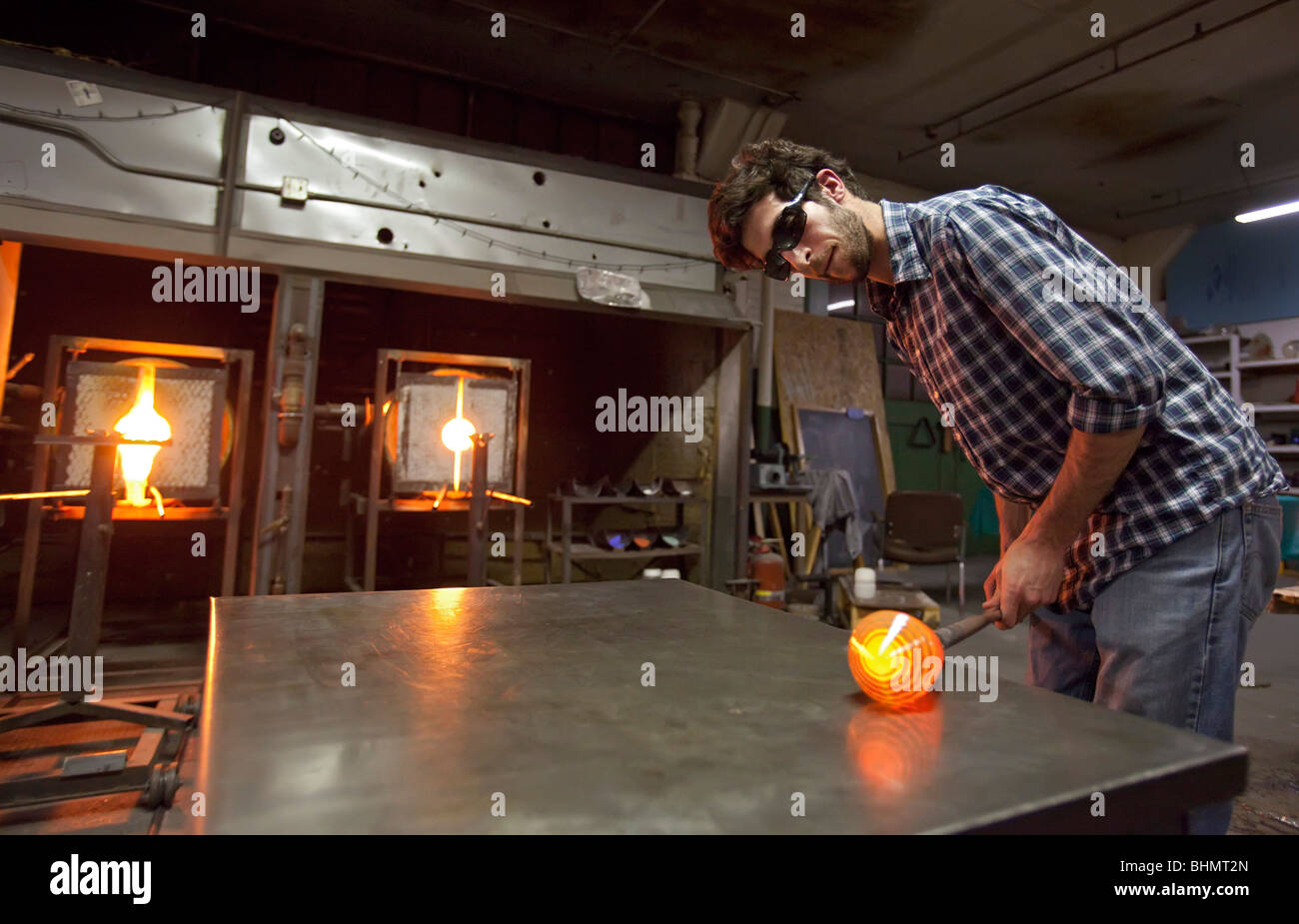Detroit, Michigan - Paul Abowd works on a glass bowl at the Michigan Hot Glass Workshop. - Stock Image