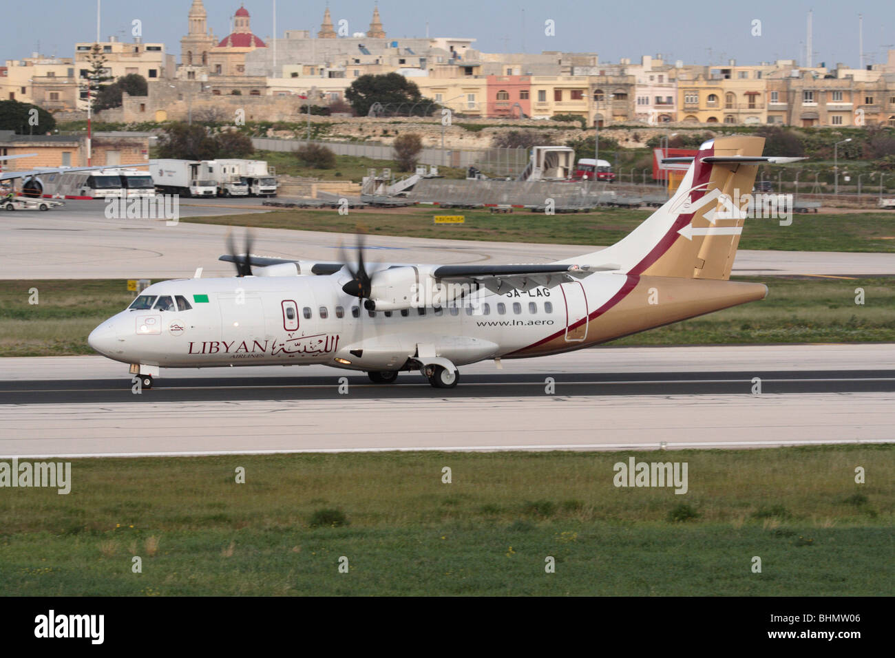 Libyan Airlines ATR 42-500 small turboprop passenger plane on the runway during takeoff from Malta - Stock Image