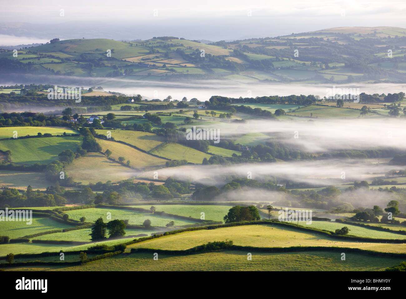 Mist covered farmland at dawn surrounding the village of Capel Gwynfe, Brecon Beacons National Park, Carmarthenshire, - Stock Image