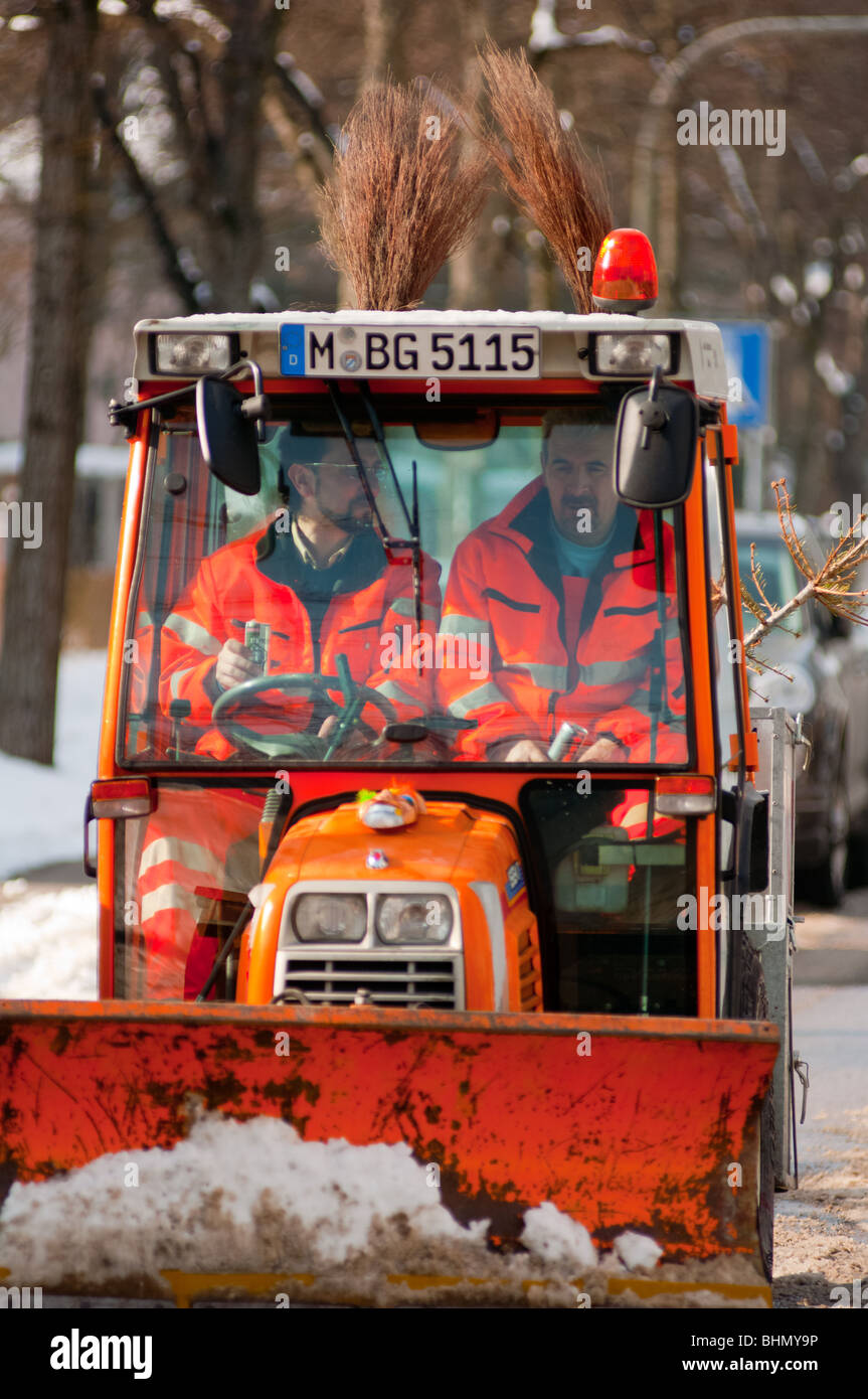 Snow plow workers closeup in Munich, Germany - Stock Image