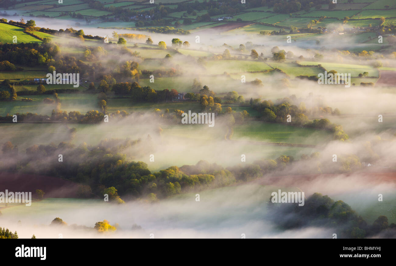 Mist blows over rolling countryside in the early morning near Talybont-on-Usk, Brecon Beacons National Park, Powys, - Stock Image