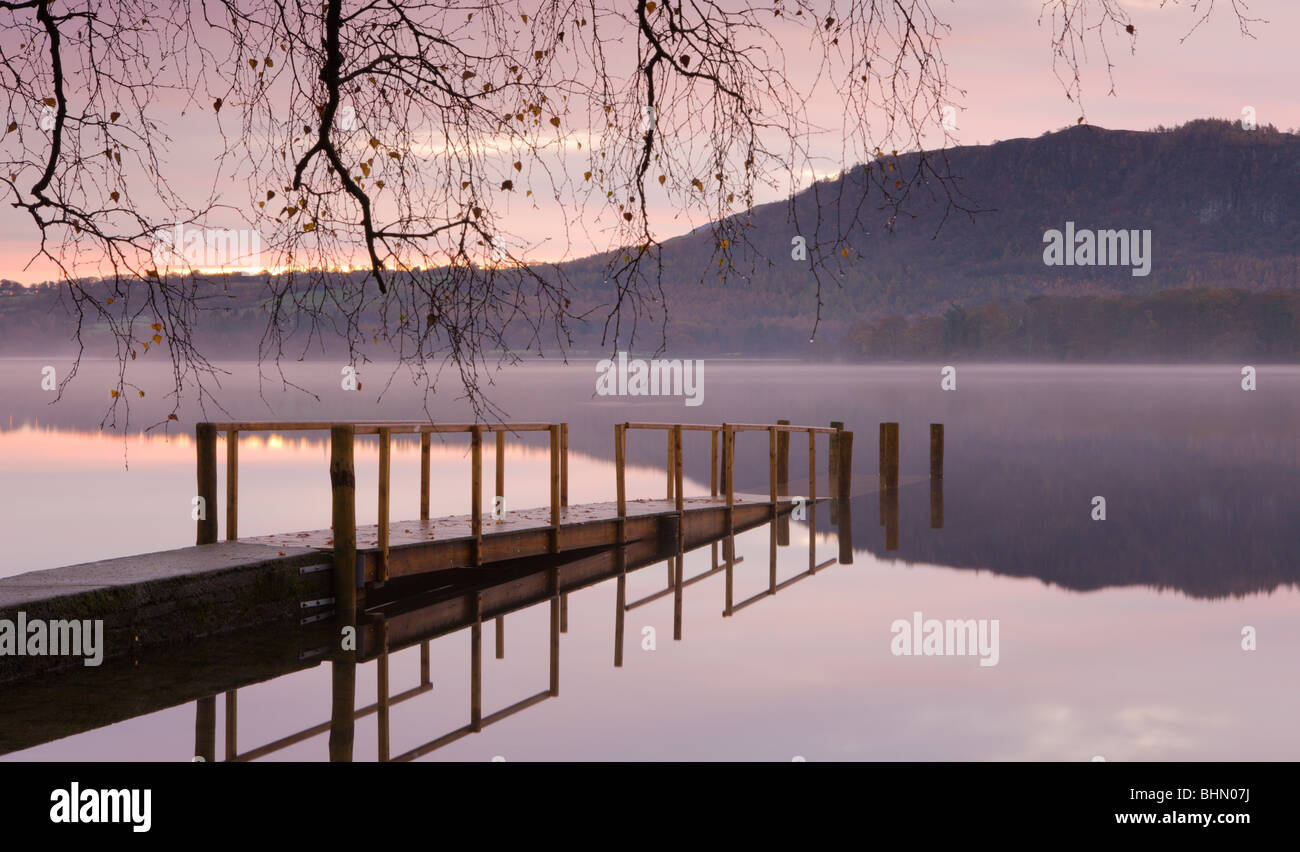 Sunrise over Derwent Water from Hawes End jetty, Lake District National Park, Cumbria, England, UK. Autumn (November) - Stock Image