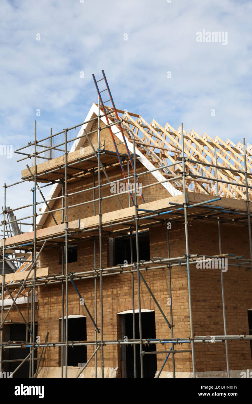 New house under constuction on a building site - Stock Image