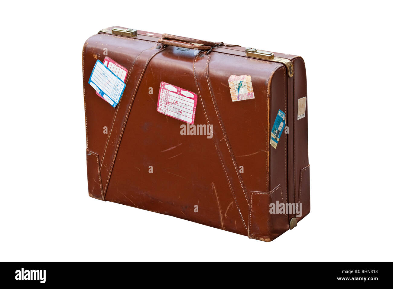 Well-travelled old leather suitcase with visa stickers Stock Photo