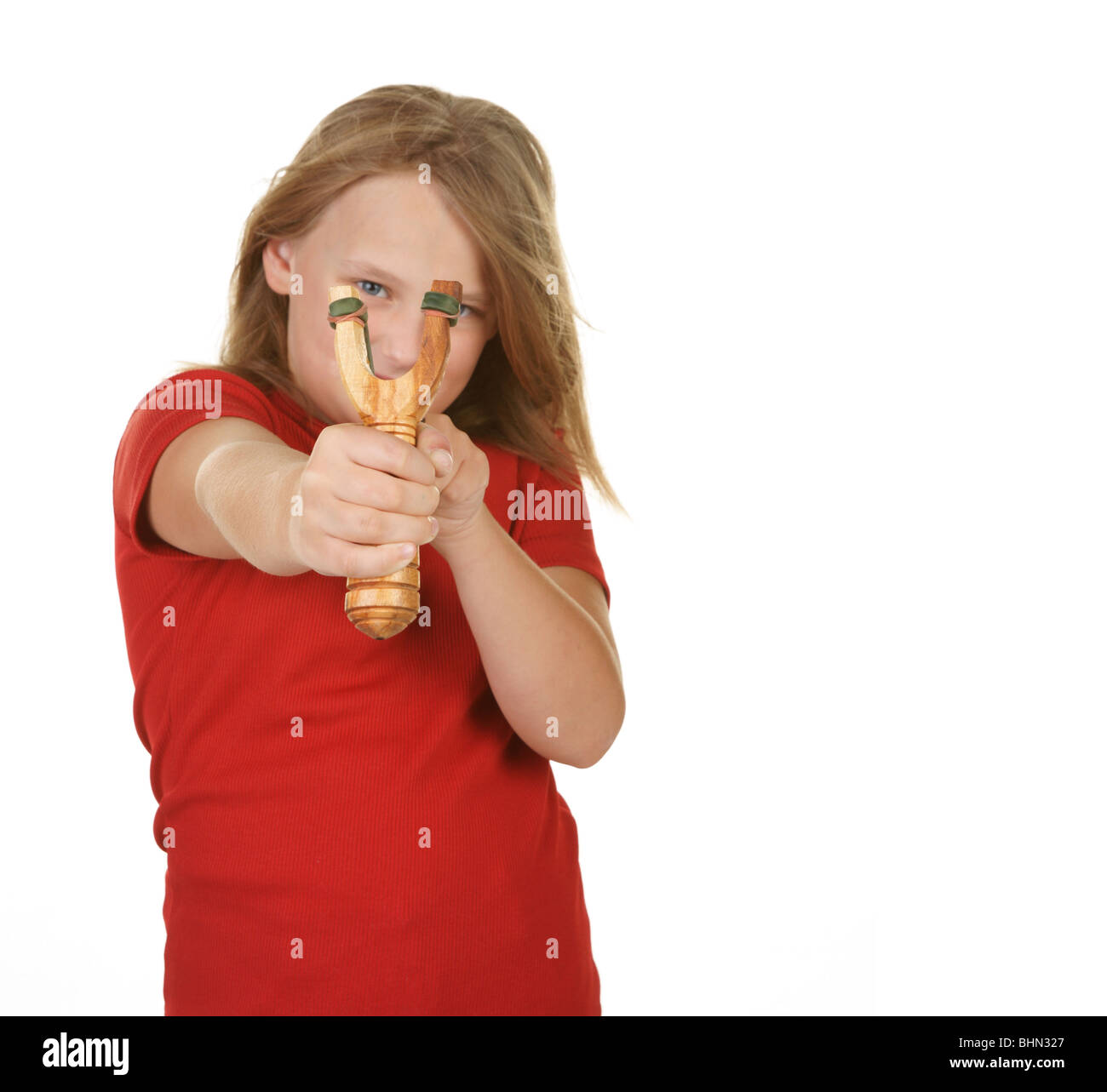 naughty little girl with a slingshot on white Stock Photo