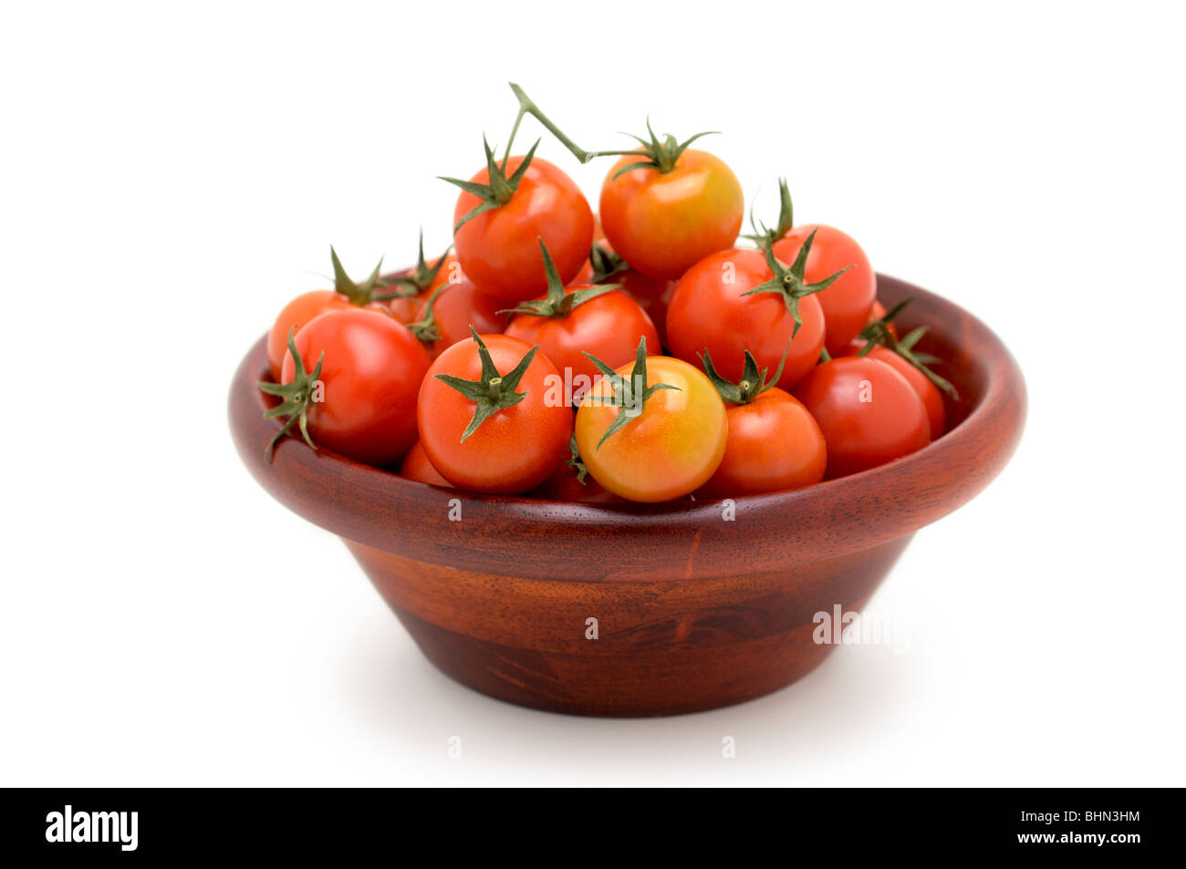Cherry Tomatoes in Wooden Bowl - Stock Image