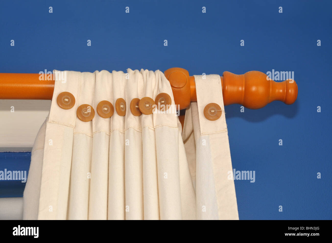 Close up of curtain attachments and railing. - Stock Image