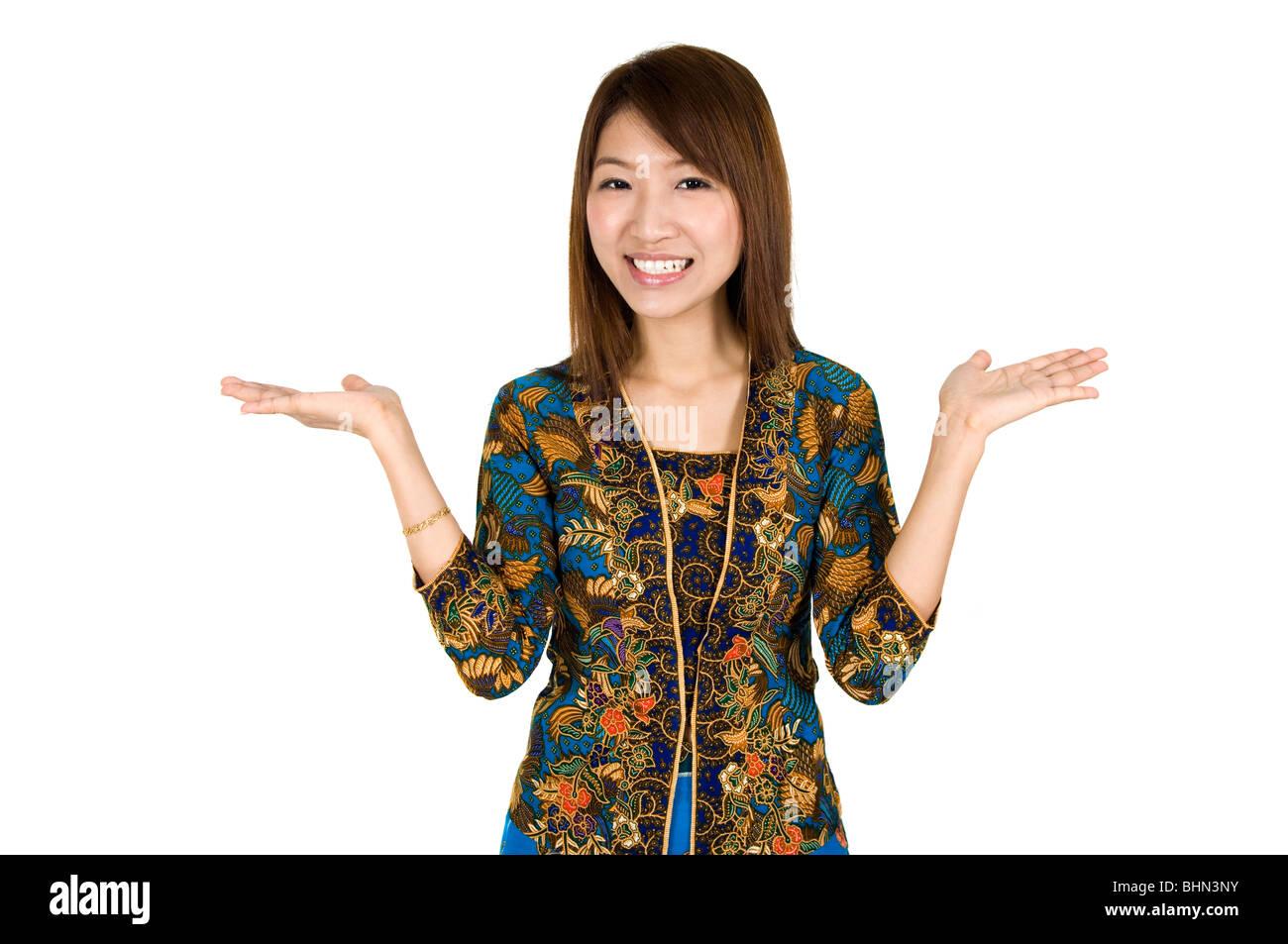 Malaysian Girl Wearing Batik Kebaya Holding Hand Showing Something