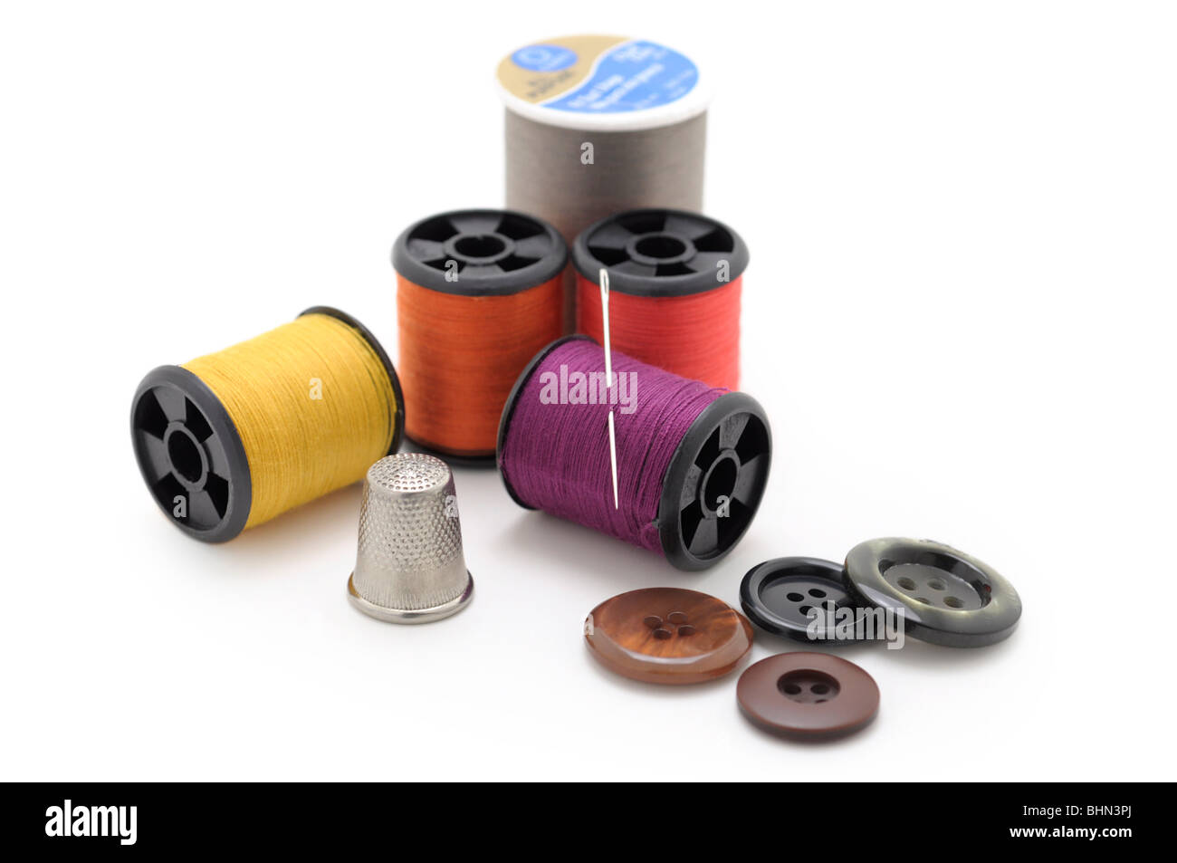 Spools of thread, Needle and Buttons - Stock Image