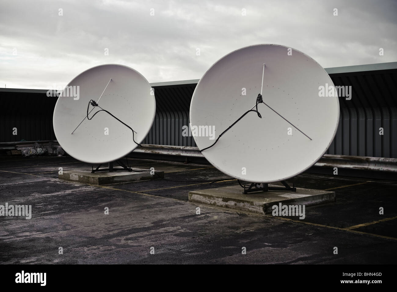 microwave satellite dish for receiving outside broadcast television signals at TV studio, UK - Stock Image
