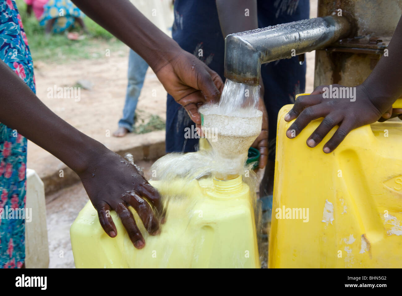 Children fetch fresh drinking water at a borehole in Amuria District, Teso Region, Uganda. - Stock Image
