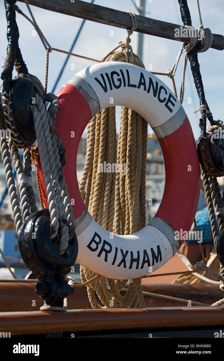 Lifebelt on the historic Brixham trawler Vigilance - Stock Image