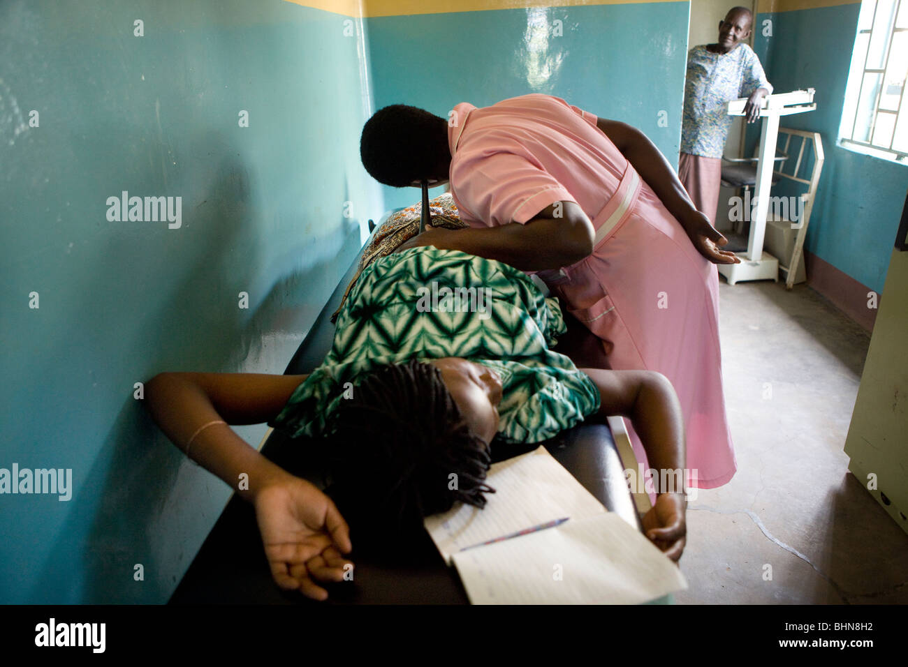 A pregnant woman receives a maternal exam in hospital in Amuria District, Teso Subregion, Uganda, East Africa. - Stock Image