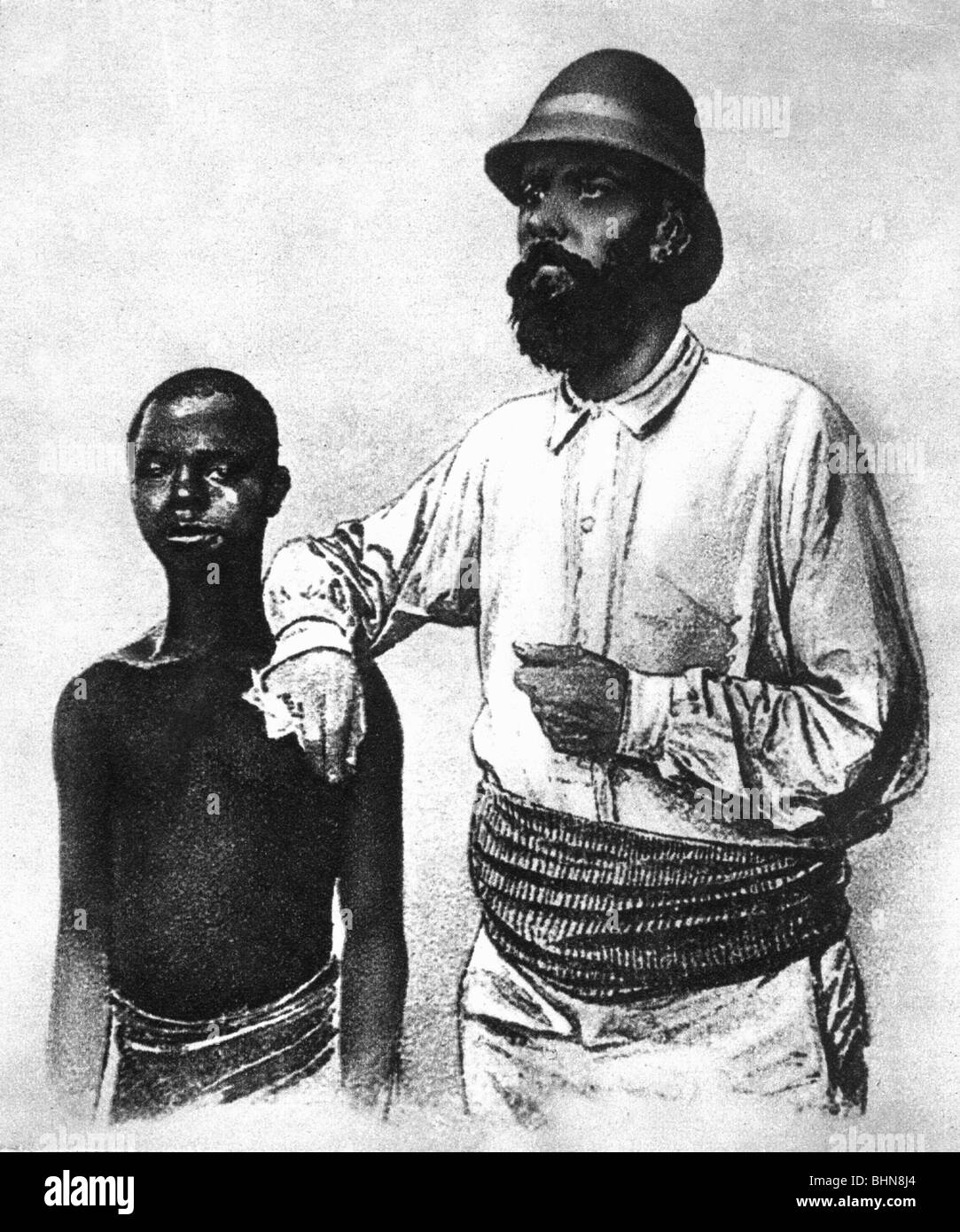 colonialism, German colony Cameroon, captain Kund with a native child, by anonymous, historic, historical, Africa, - Stock Image