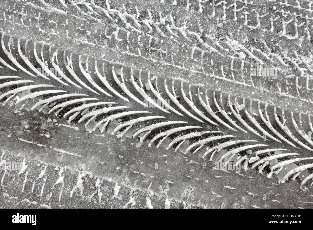 Tyre tracks in ice. - Stock Image