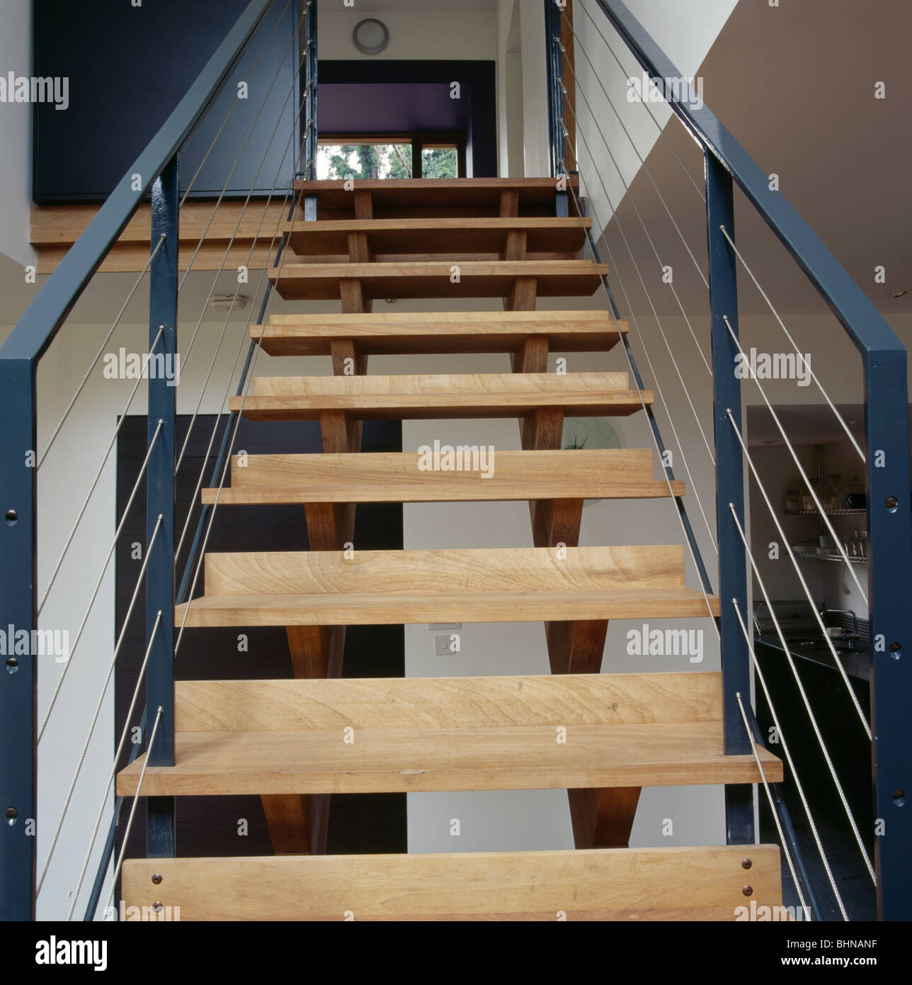 Close Up Of Modern Staircase With Open Wooden Treads Stock Photo