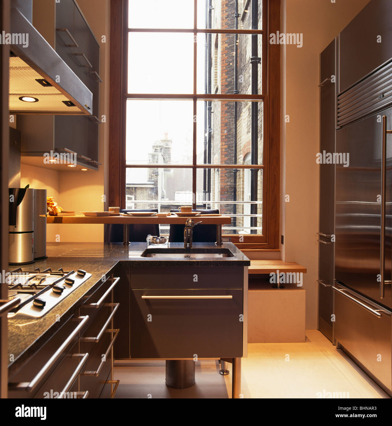 recessed lighting above oven in modern apartment kitchen with large window recessed82 large