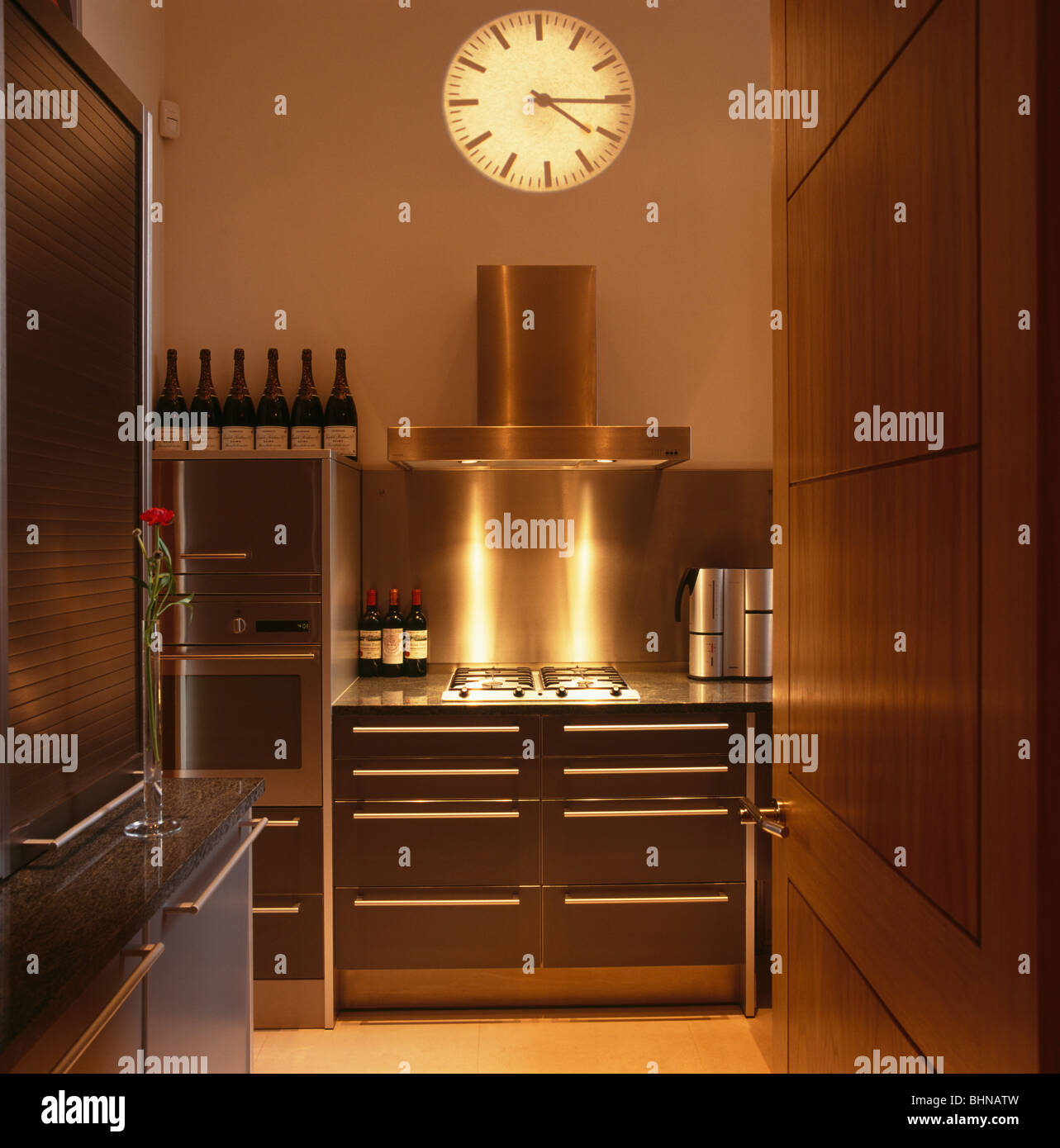 Hologram Clock On Wall Above Stainless Steel Extractor Fan And Range Stock Photo Alamy