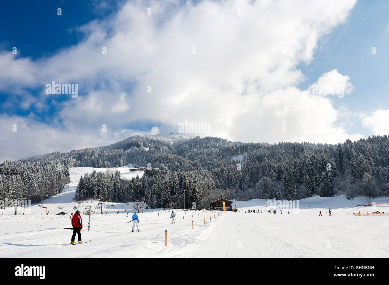 Drag lift and nursery slopes just outside the resort centre, Westendorf, Tyrol, Austria - Stock Image