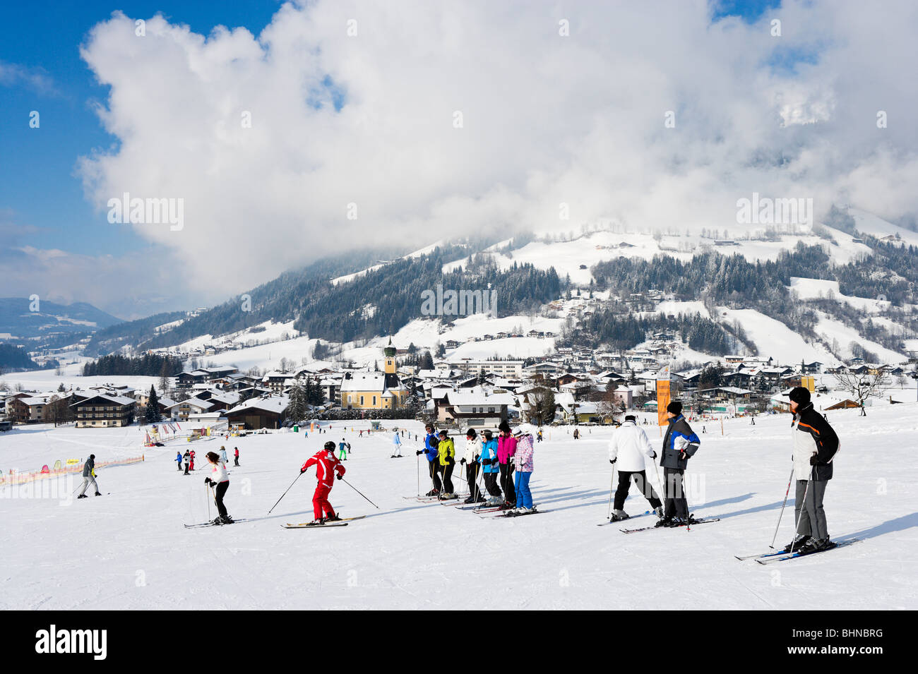 Ski school lesson on the nursery slopes just outside the resort centre, Westendorf, Tyrol, Austria - Stock Image