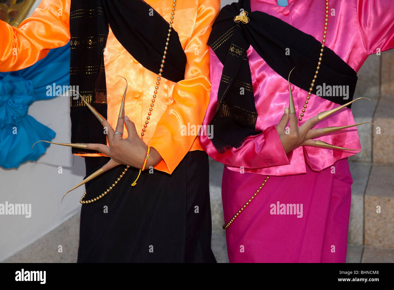 Thai dancers with ornate extended exotic finger nails, golden extensions, using beautifully executed finger and - Stock Image