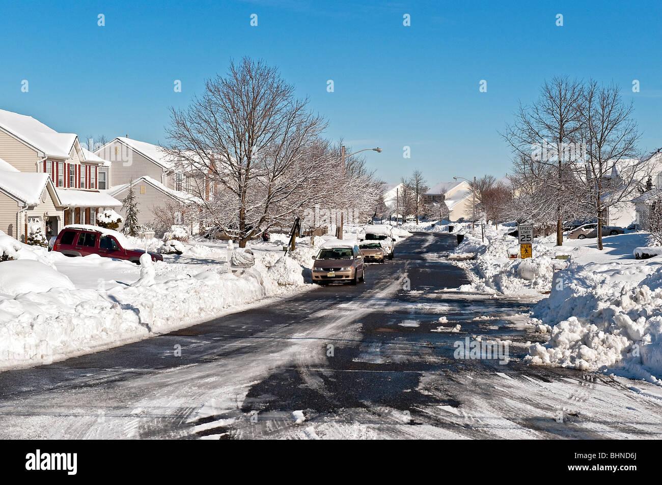 Snow bound suburban housing development. - Stock Image