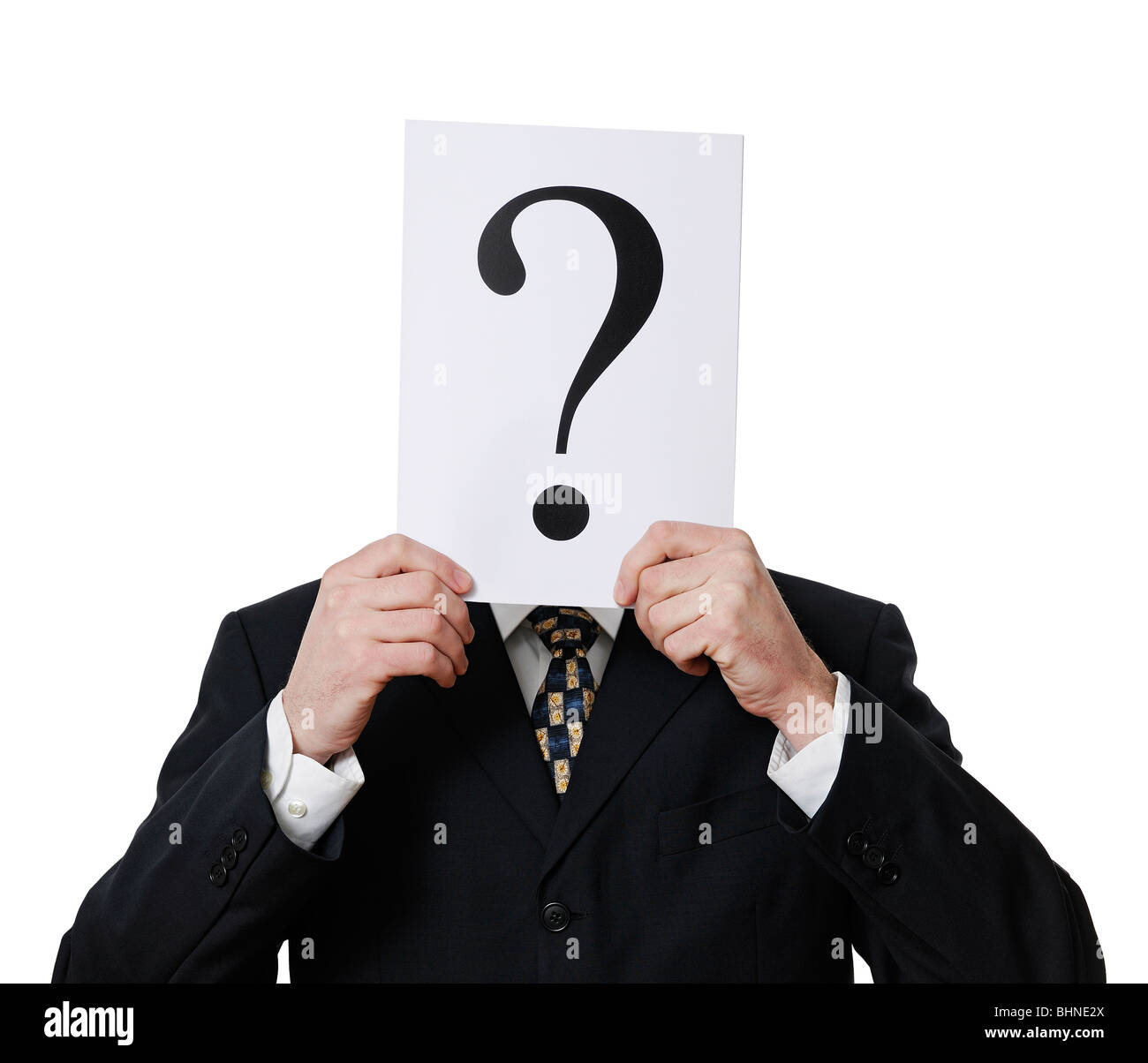 Anonymous Businessman Holding a Question Mark in Front of His Face - Stock Image