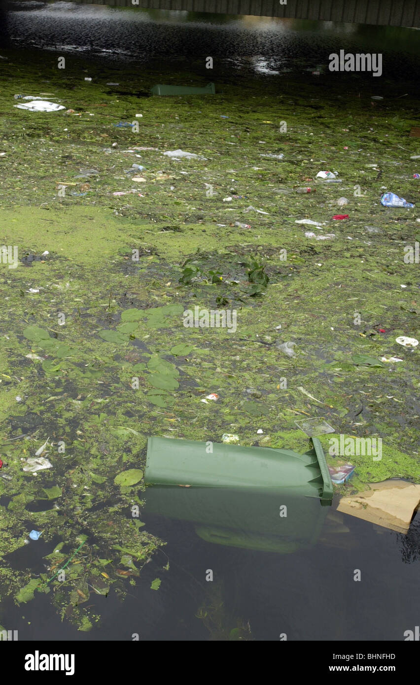 Dumped rubbish in the river Great Ouse at Bedford UK - Stock Image