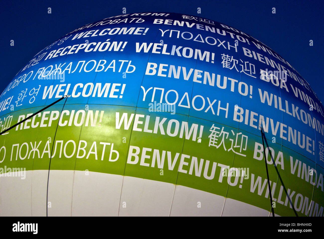 Large helium inflated dome balloon proclaiming welcome to world in many languages for Vancouver 2010 Winter Olympics - Stock Image