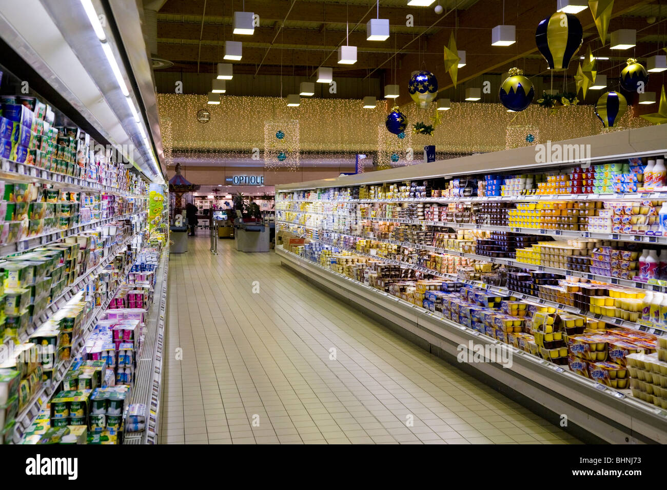 A display of food and dairy product / products in the chiller cabinet refrigerator / fridges in a French supermarket. France. & A display of food and dairy product / products in the chiller ...