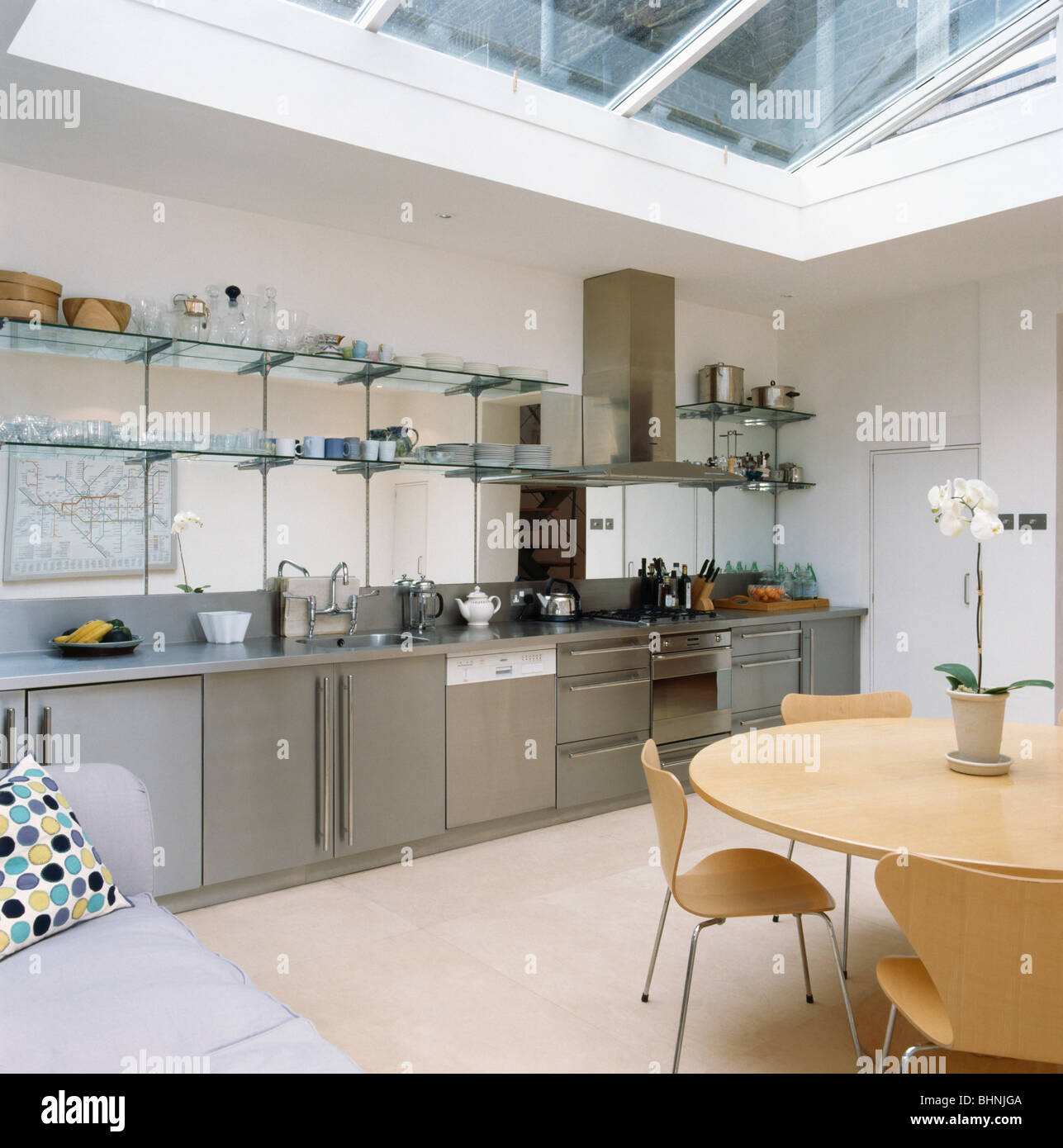 glass shelving above stainless steel fitted units in modern kitchen rh alamy com