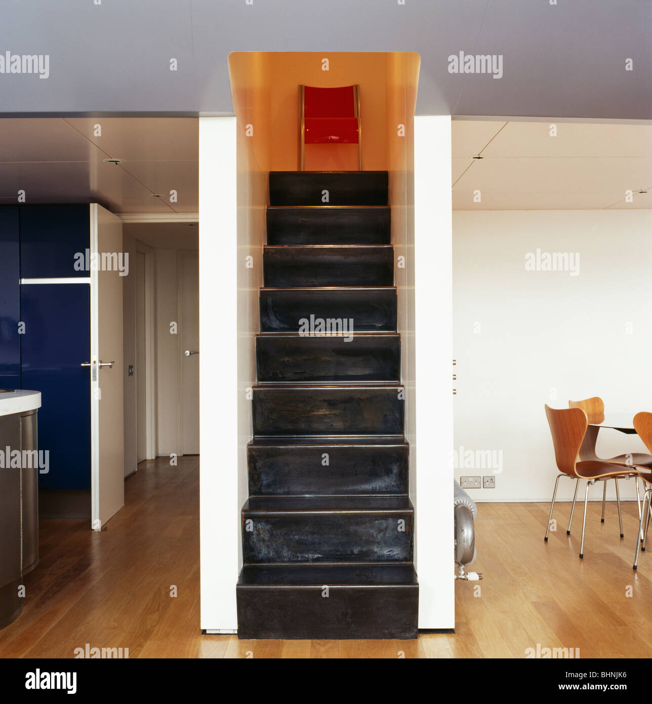 Narrow Black Metal Staircase In Open Plan Apartment In City Loft
