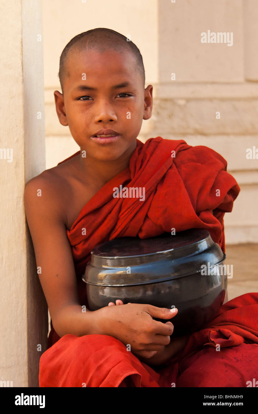 Young monk in red robe Stock Photo