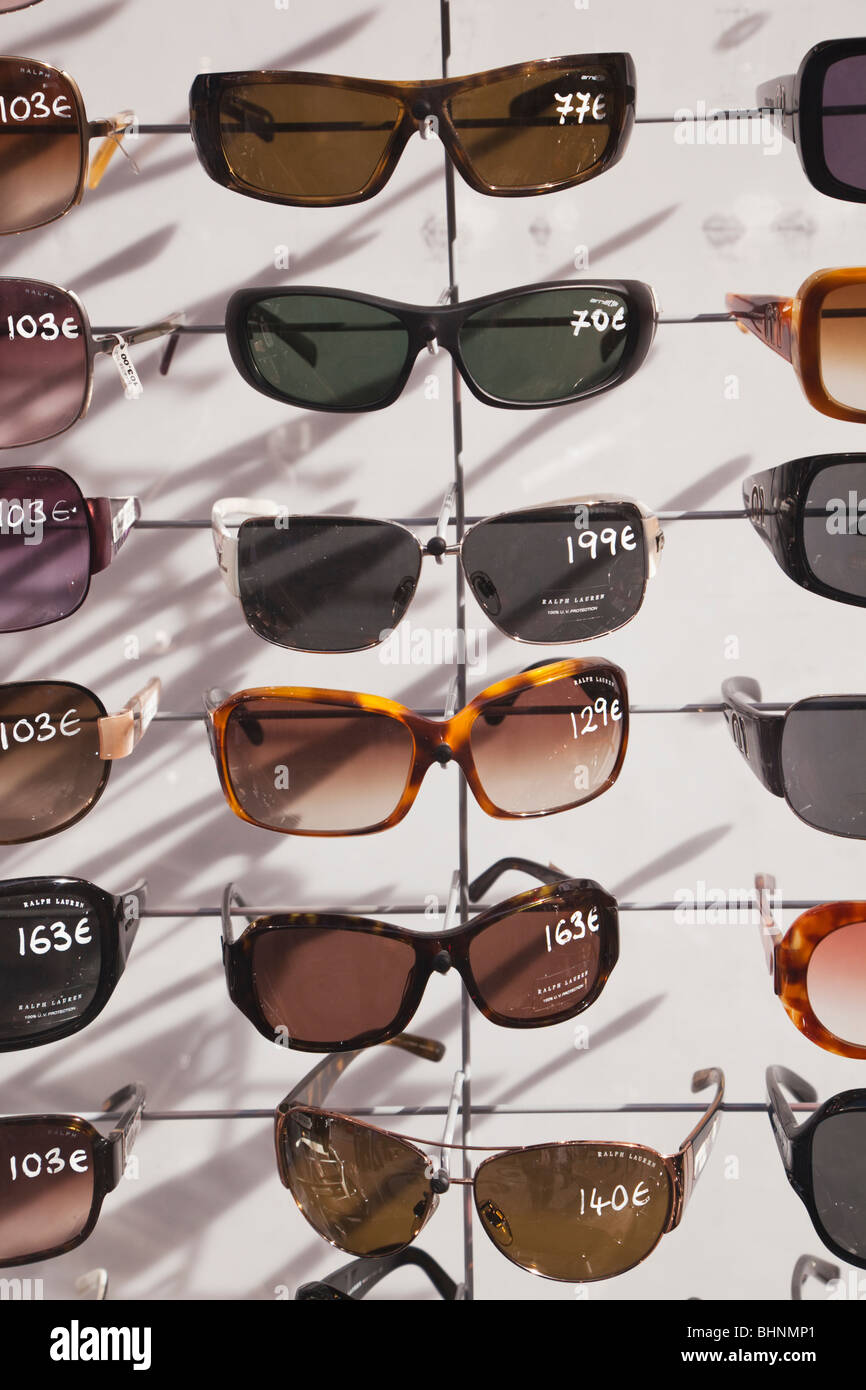 Stand with selection of sun glasses for sale in Torremolinos, Spain - Stock Image
