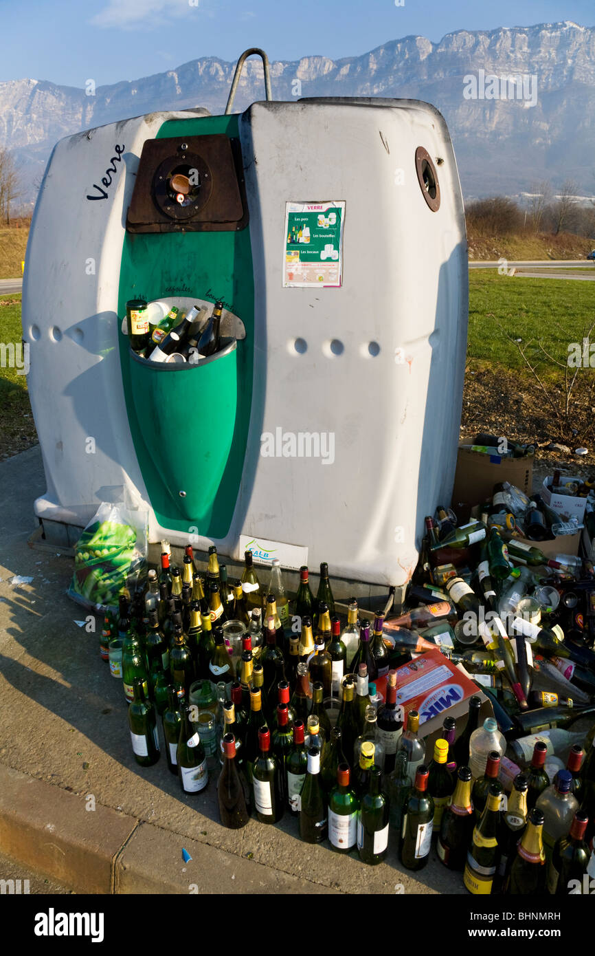 Overflowing / full recycling collection point and bottle bank near Aix les Bains. Savoie (Savoy) (Alpine) department Stock Photo