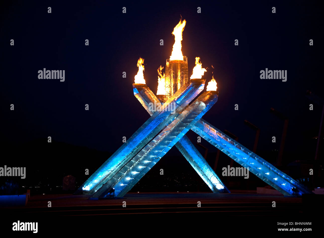 The Olympic Cauldron burns against a darkening sky during the Vancouver 2010 Winter Olympic Games - Stock Image