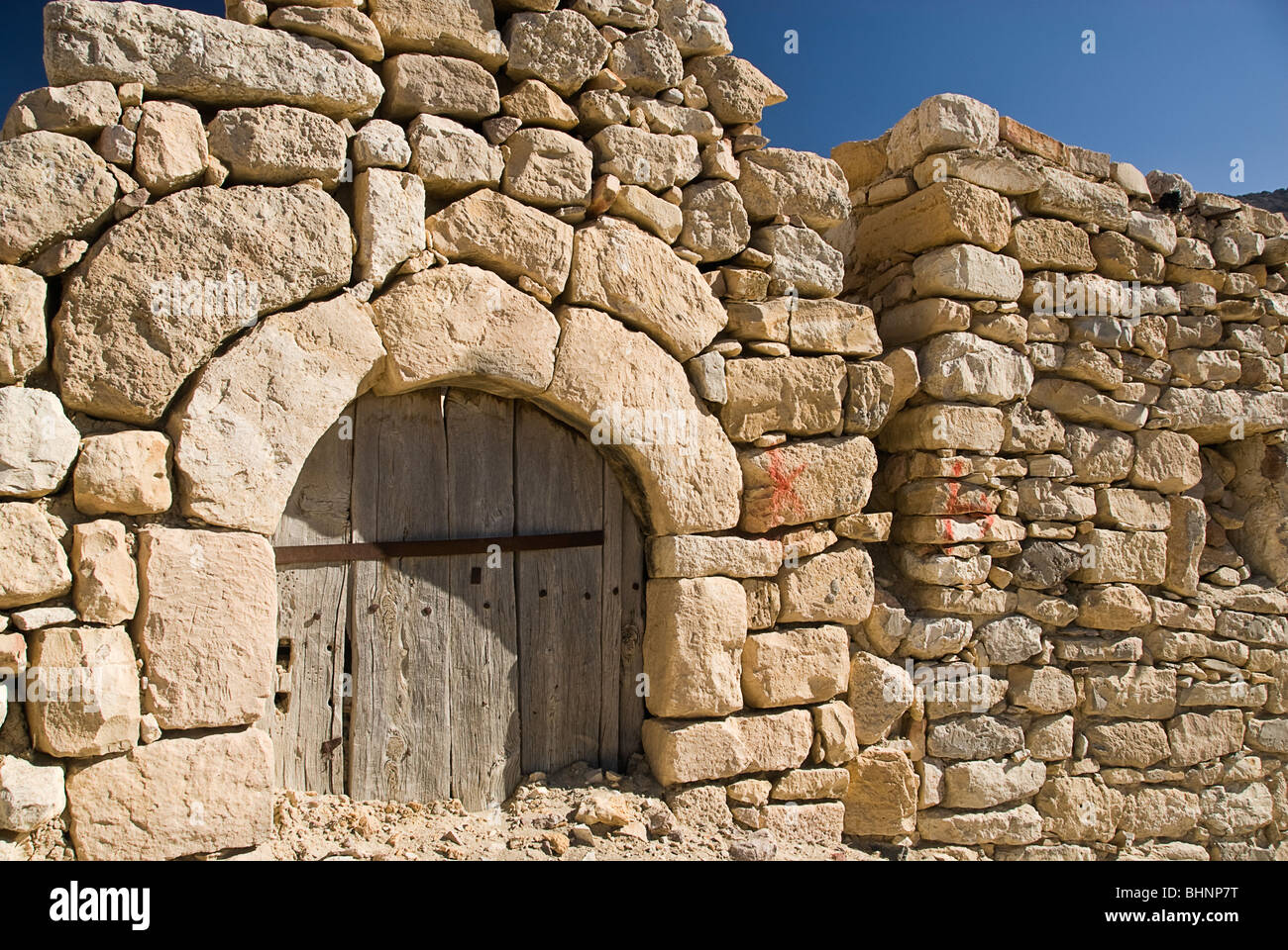 Ruins of an old house collapsed in the small village of Dana,Jordan,Asia. - Stock Image