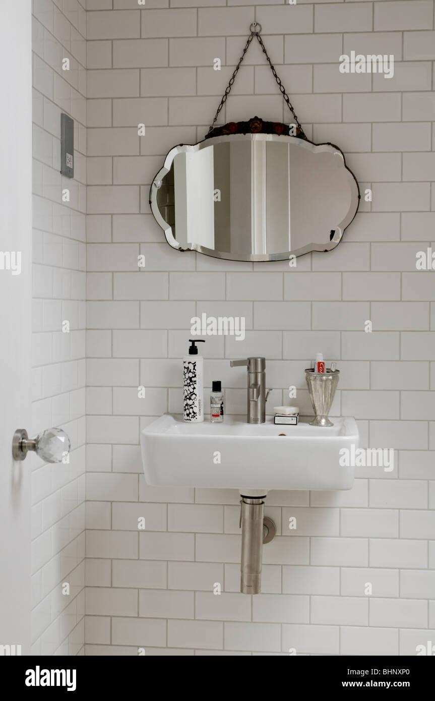 Washbasin And Antique Mirror In Modern Running Bond Tiled Bathroom