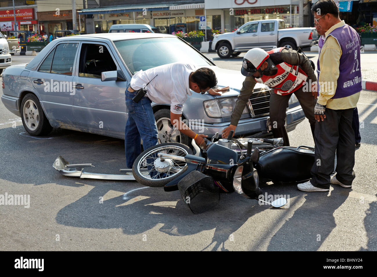 Road accident involving a car and a motorcycle with police