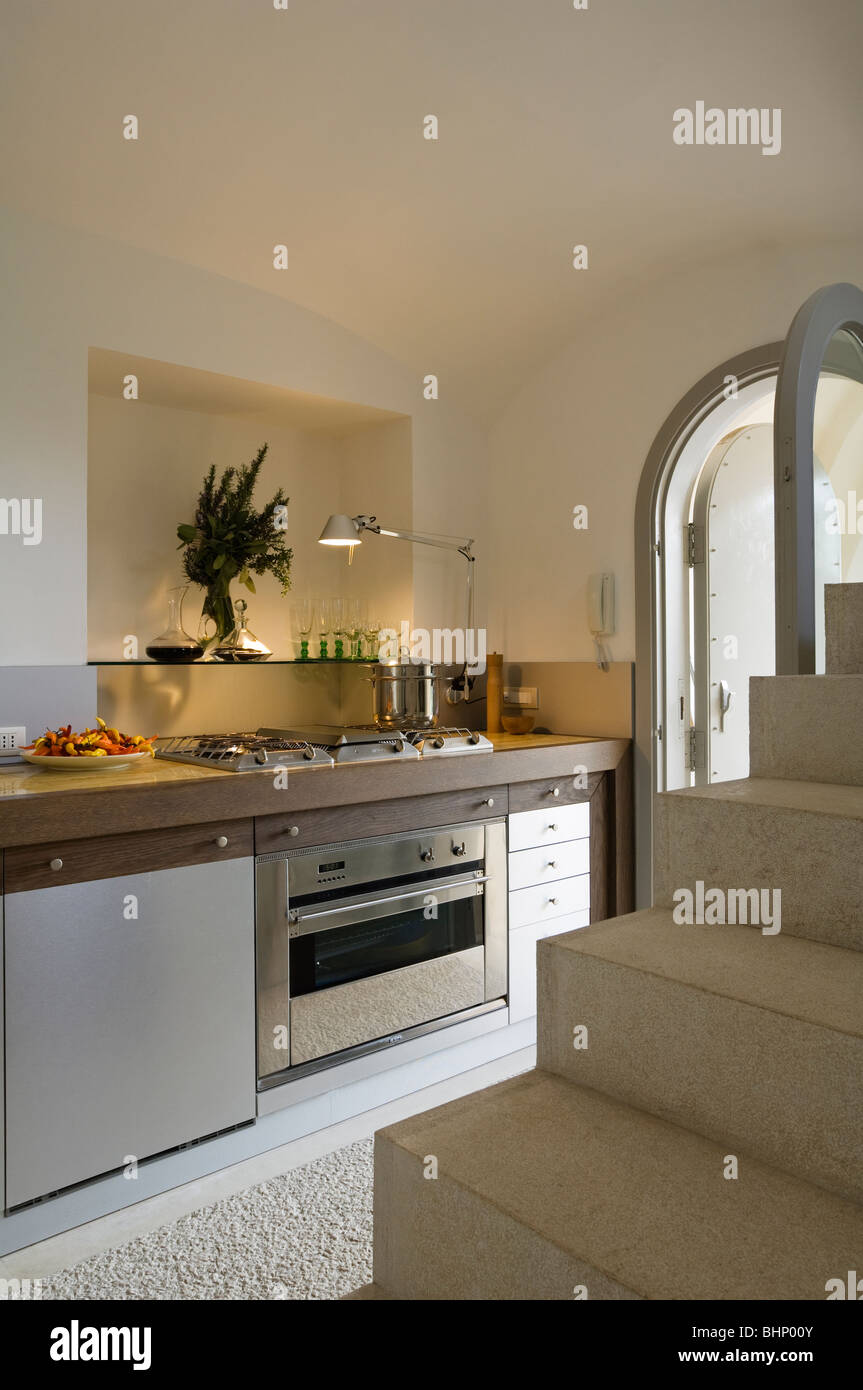 Kitchen With Stairs In Italian Farmhouse Conversion Stock Photo