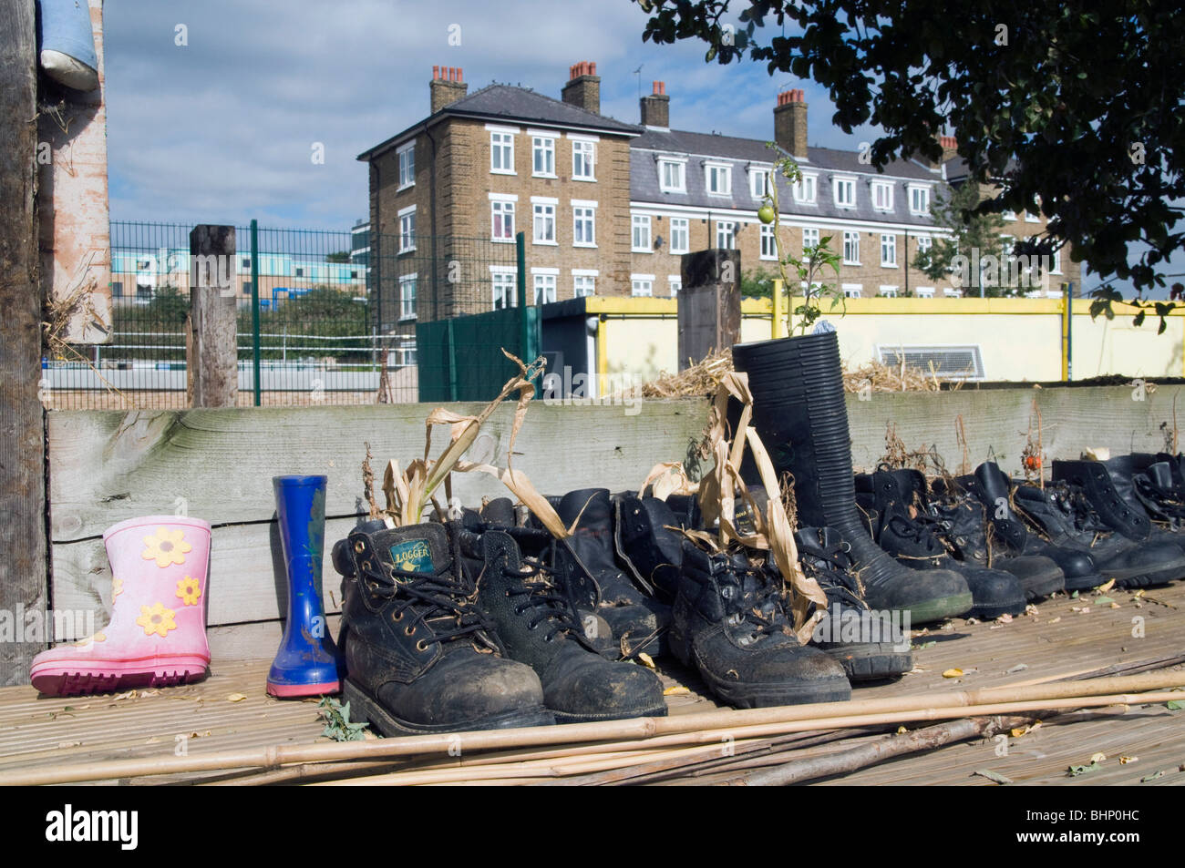 UK.Volunteers' boots by vegetable allotment at Spitalfields City Farm in east London - Stock Image