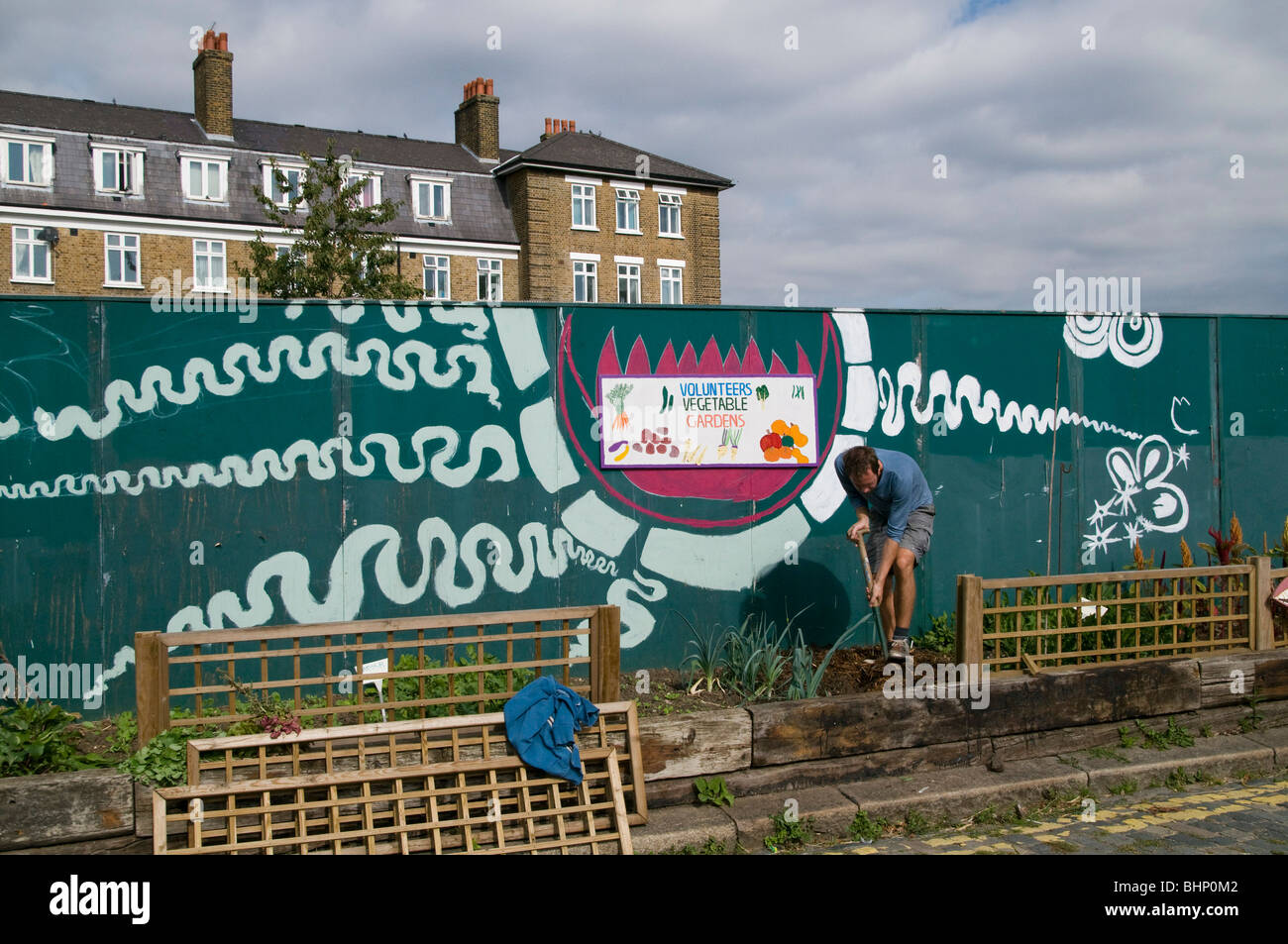UK.Volunteer working at the vegetable allotment at Spitalfields City Farm in east London - Stock Image