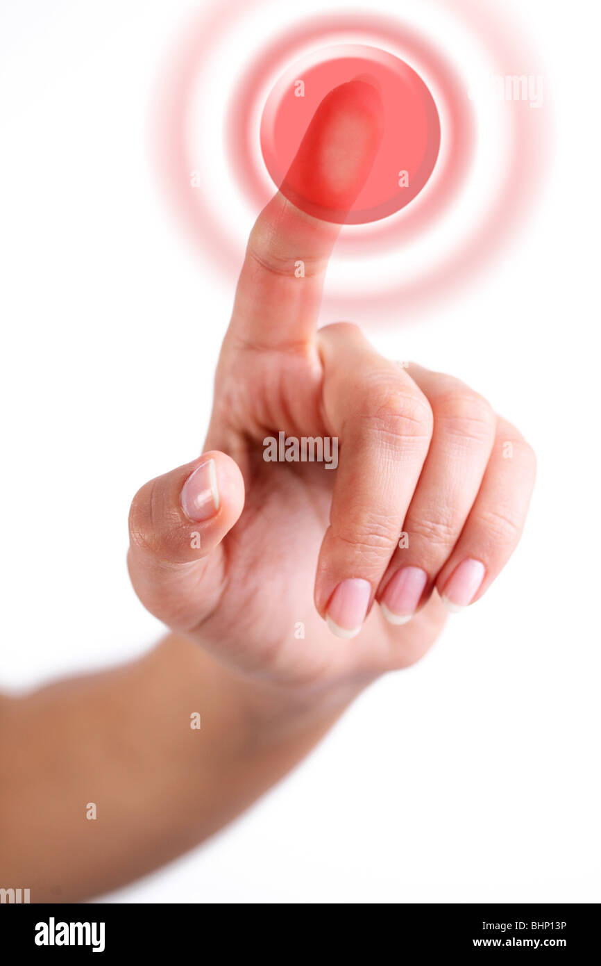 Red button pushed with finger - Stock Image