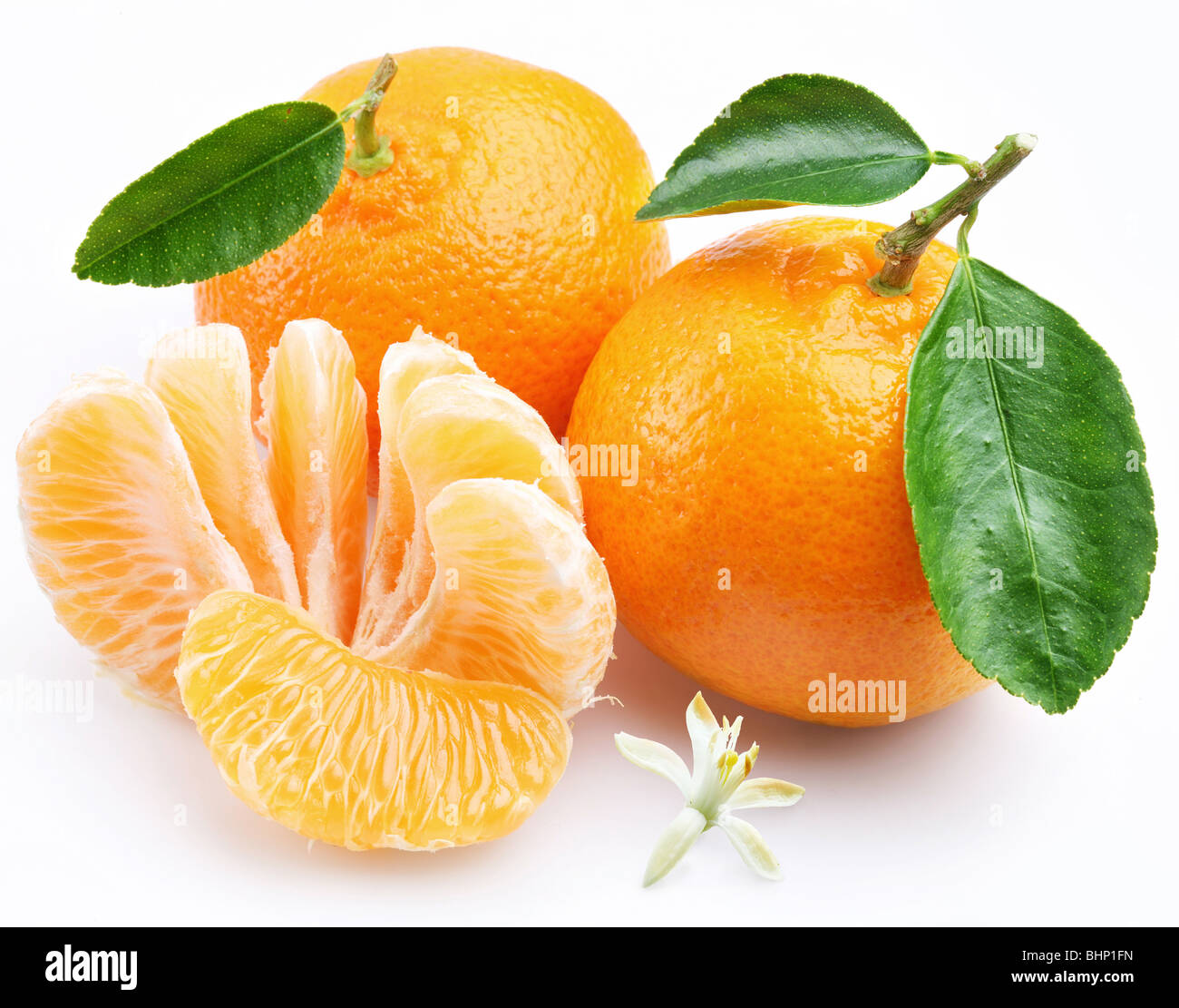 Tangerine with segments on a white background - Stock Image